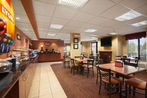 breakfast buffet with table and chair seating at Ramada by Wyndham Wisconsin Dells