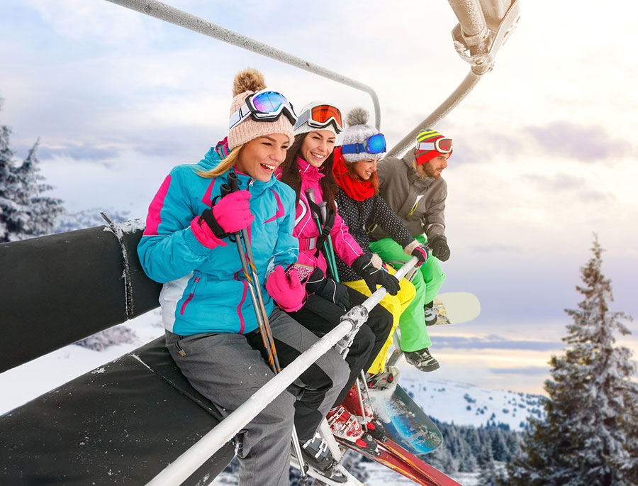 Save Download Preview group of cheerful friends are lifting on ski-lift for skiing in the mountains